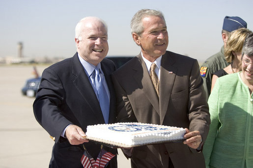Bush and McCain laughing over birthday cake