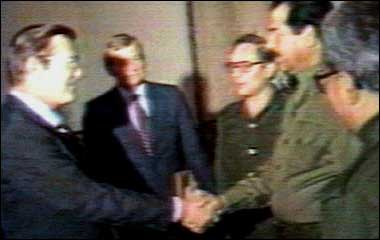 Rumsfeld shakes hands with Saddam